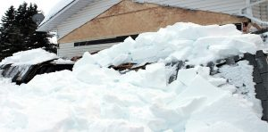 heavy snowfall collapses roof